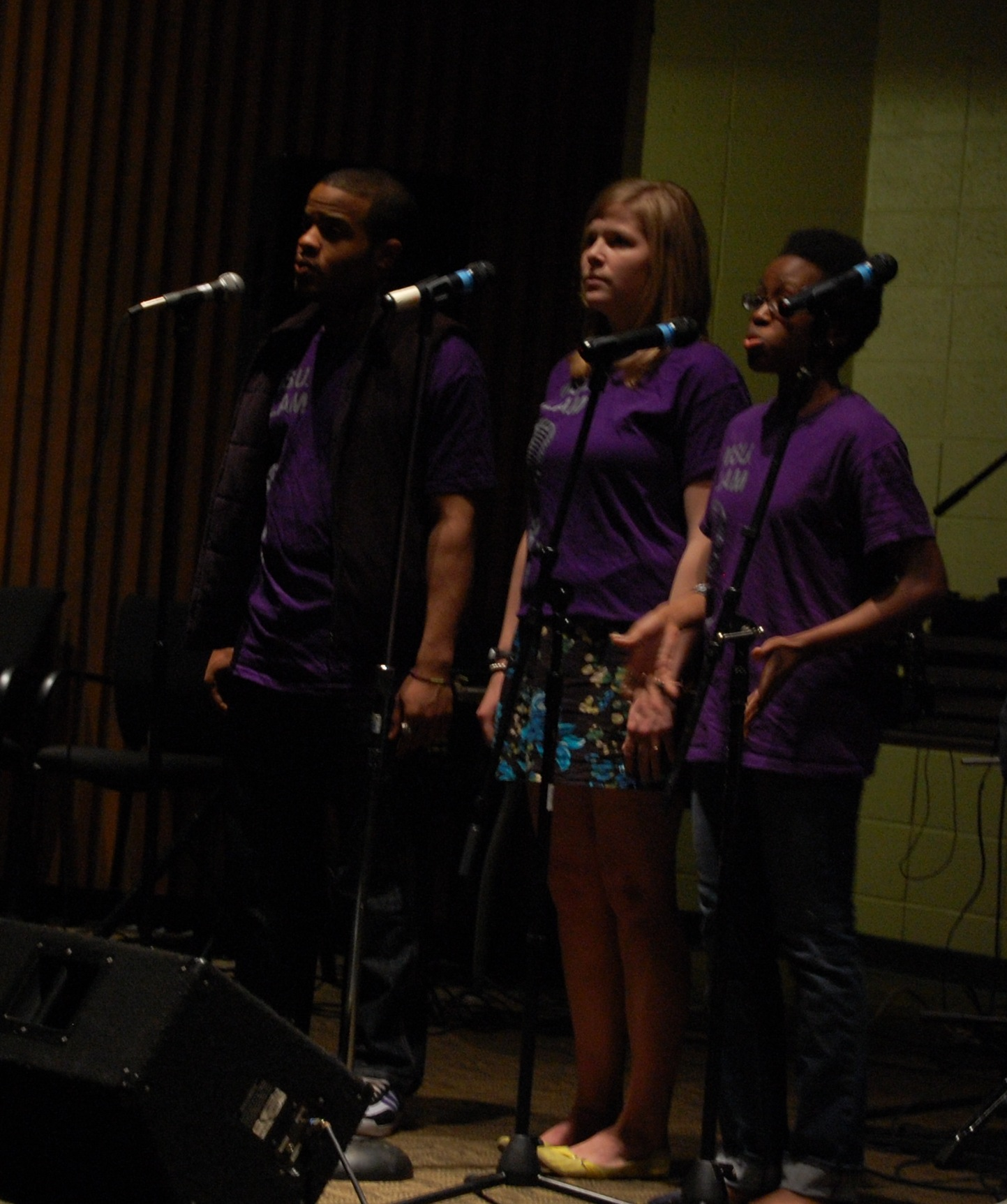 Michelle Hooks, on right, with MSU Poetry Slam members. (Photo by Solomon Martin)